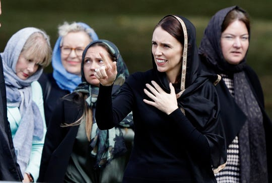 New Zealand Prime Minister Jacinda Ardern, second right, gestures as she leaves Friday prayers at Hagley Park in Christchurch, New Zealand, Friday, March 22, 2019. People across New Zealand are observing the Muslim call to prayer as the nation reflects on the moment one week ago when 50 people were slaughtered at two mosques. (AP Photo/Mark Baker)