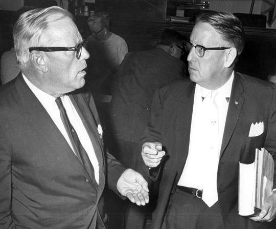 Sen. Verle Pope and Sen. Charley Johns talk on the Senate floor in 1963
