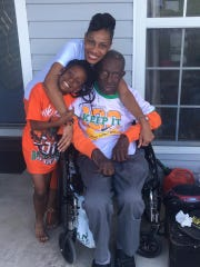 Hoover SoulTrain Lawrence shares a moment with his granddaughter Destiny Maxwell, 8, (right) and daughter, Stacey Maxwell.