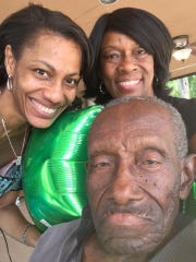 Stacey Lawrence Maxwell (left) and Verneka Lawrence Rhodes gathered with Hoover SoulTrain Lawrence to celebrate their father's final birthday on April 14, 2018.