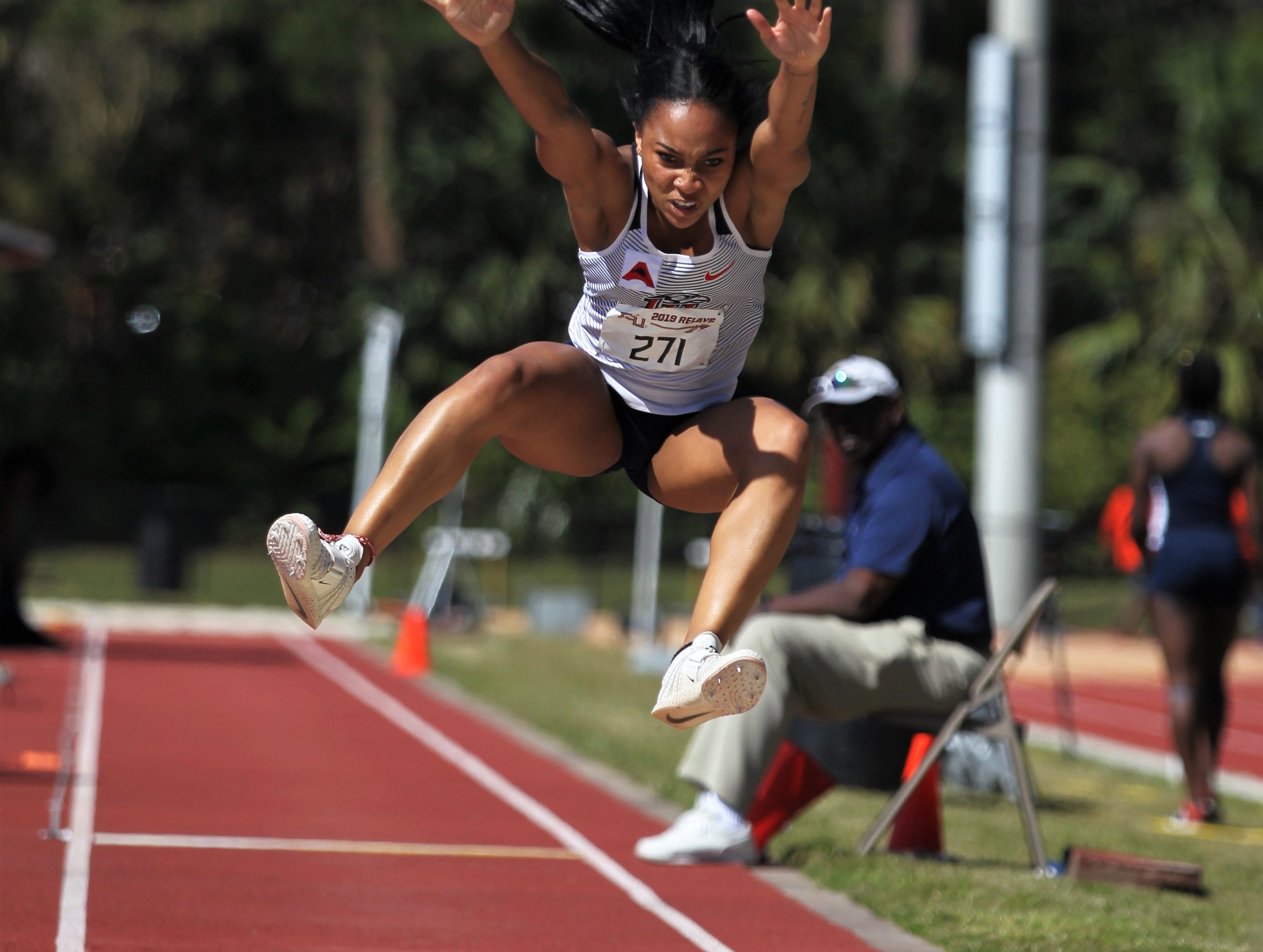 Liberty sophomore Adrianna Mitchell, a Florida High alum, triple jumps during Friday's college portion of the FSU Relays at Mike Long Track on March 22, 2019.