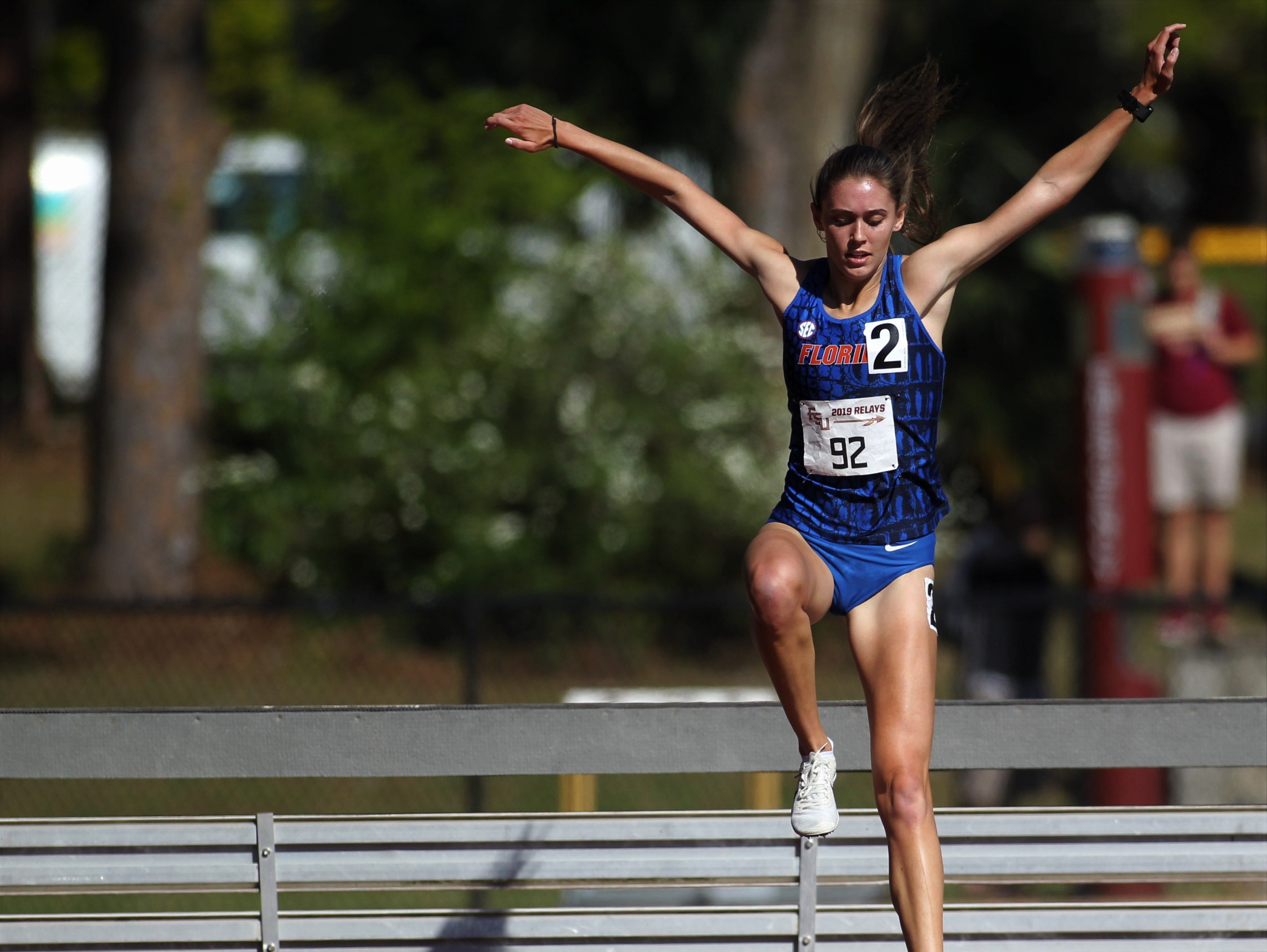 Florida's Grace Blair prepares to land in the water in the 2000-meter steeplechase during Friday's college portion of the FSU Relays at Mike Long Track on March 22, 2019.
