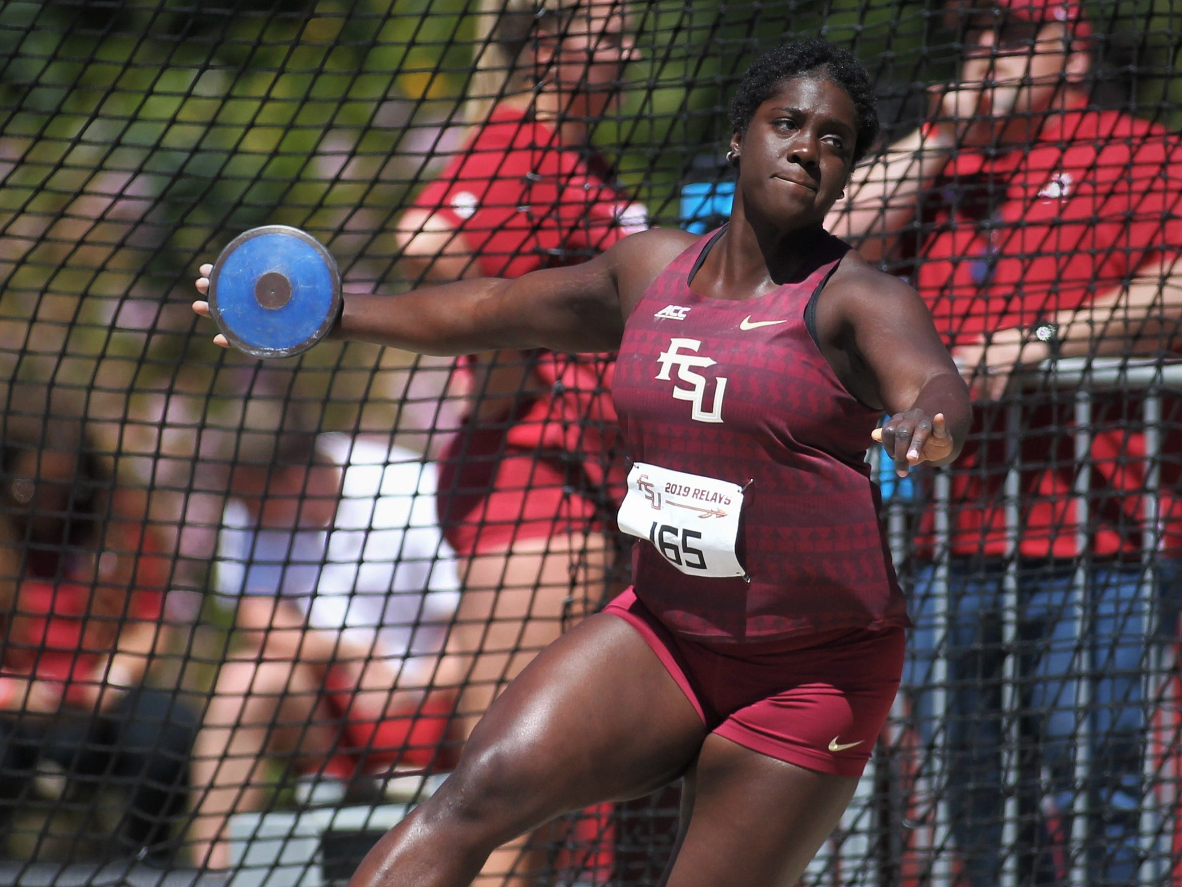 Florida State junior Shanice Love throws discus during Friday's college portion of the FSU Relays at Mike Long Track.