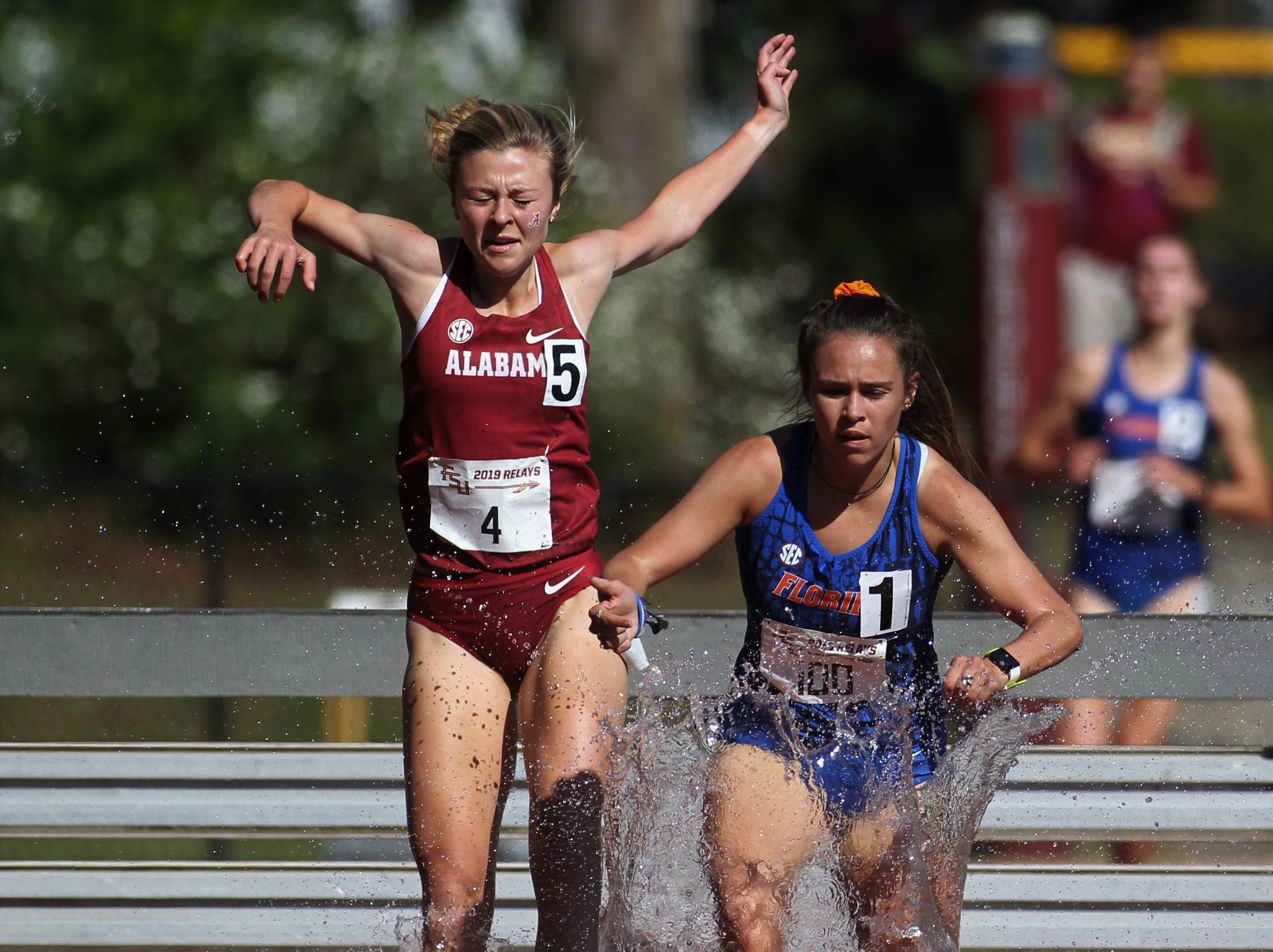 Florida's Caitlin McQuilkin leads Albama's Caroline Brooks into the water of the 2000-meter steeplechase during Friday's college portion of the FSU Relays at Mike Long Track on March 22, 2019.