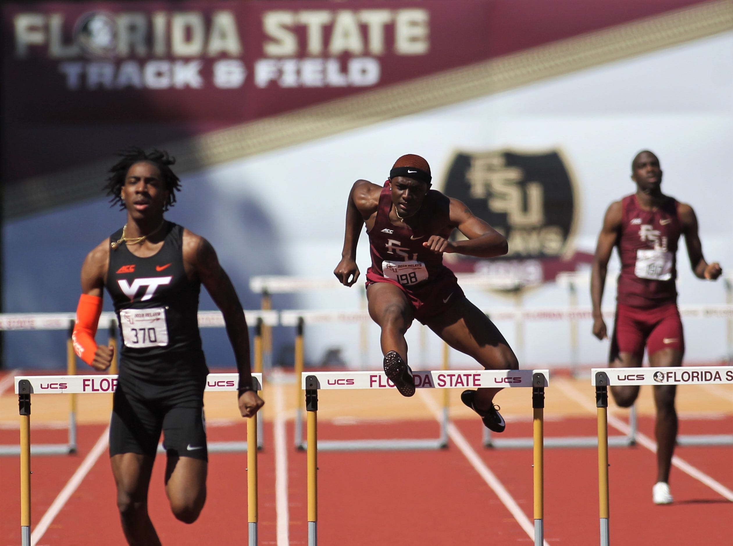Florida State sophomore Tyricke Highman, a Godby alum, runs the 400-meter hurdles during Friday's college portion of the FSU Relays at Mike Long Track on March 22, 2019.