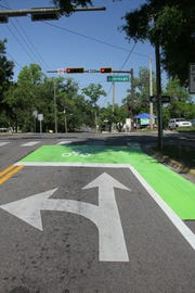 Green bike boxes painted on road surfaces at some intersections give bikers extra space and visibility.