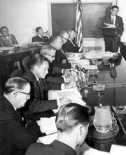 State Sen. Charley Johns, seated front left, meets with the Legislative Investigation Committee in 1964.