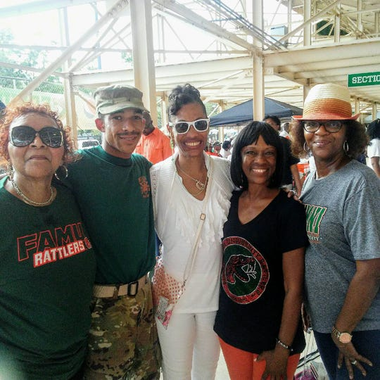 Hoover SoulTrain Lawrence's family gather for a football game at Bragg Memorial Stadium. From left to right: Bernice Henderson (cousin), Jonathan Rhodes (grandson), Stacey Lawrence Maxwell (daughter), Verneka Rhodes (daughter) and Toni Anderson (cousin).