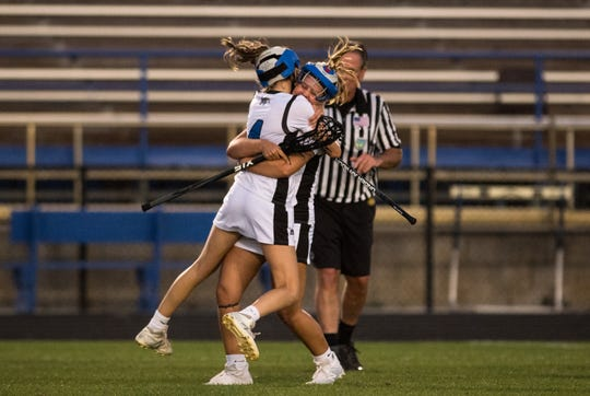 Martin County's Abagail Harrison (right) embraces Saige Roe after teammate Kayla Dusharm scores the go-ahead goal against Jensen Beach during the second half of the high school girls lacrosse game Thursday, March 21, 2019, at Martin County High School in Stuart. Martin County beat Jensen Beach 14-12.