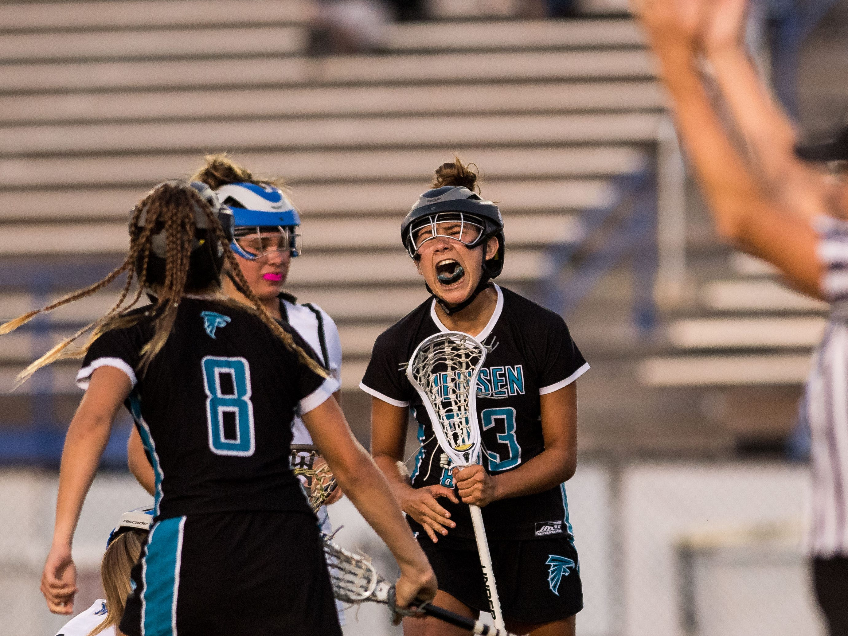 Jensen Beach's Sandy Edwards yells out after scoring the tying goal during a rally in the second half against Martin County at the high school girls lacrosse game Thursday, March 21, 2019, at Martin County High School in Stuart. Martin County jumped back ahead in the final minutes to beat Jensen Beach, 14-12.