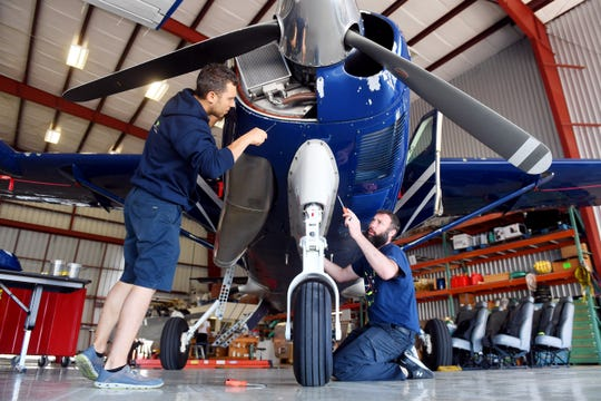 Mechanic Even Duda (left) and chief inspector Chris Wesley remove the cowling from around the engine of a Cessna 208 Caravan on Friday, March 22, 2019, in the hangar of Fly the Whale, a charter aircraft company, at the Treasure Coast International Airport and Business Park in St. Lucie County. The airline has decided to no longer offer scheduled service to Tallahassee, ending the return of commercial air service to the county. The airline will continue to offer charter flights and announced it will open a base in San Juan, Puerto Rico, where it provides charter flights to Tortola in the British Virgin Islands.