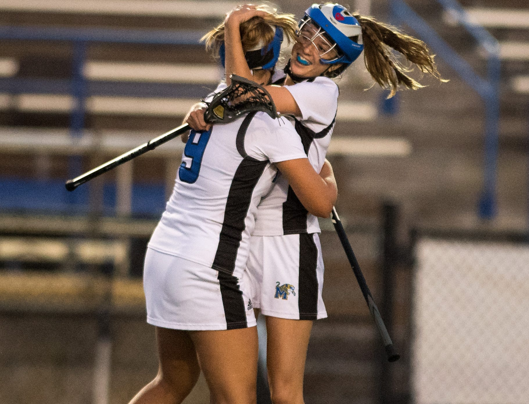 Martin County's Saige Roe (right) embraces Abagail Harrison after teammate Kayla Dusharm scores the go-ahead goal against Jensen Beach during the second half of the high school girls lacrosse game Thursday, March 21, 2019, at Martin County High School in Stuart. Martin County beat Jensen Beach 14-12.