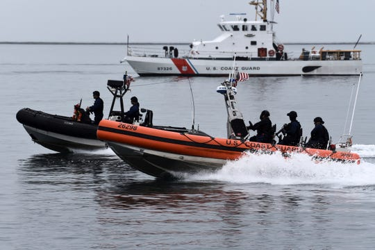 U.S. Coast Guard Maritime Security Response Team-West crew members conduct a tactical demonstration in the Port of Los Angeles on Thursday.