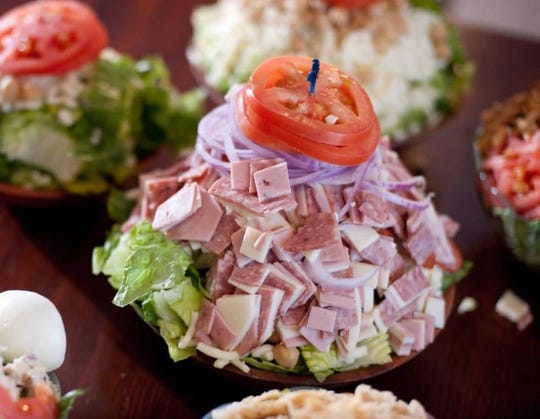 The Original Pizza Cookery is known for its towering antipasto salad stacked with mozzarella, provolone, cotto salami and mortadella and topped with tomato slices.