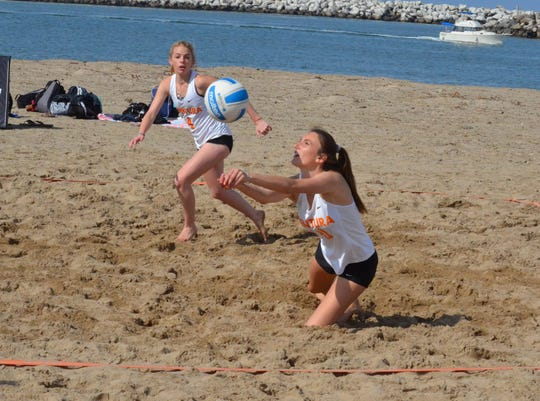 Brooklyn Wallet, right, and Faith Mackie came back from a set down to lift the Ventura College beach volleyball team to a 3-2 win over rival Moorpark College at Ventura Harbor on March 15.