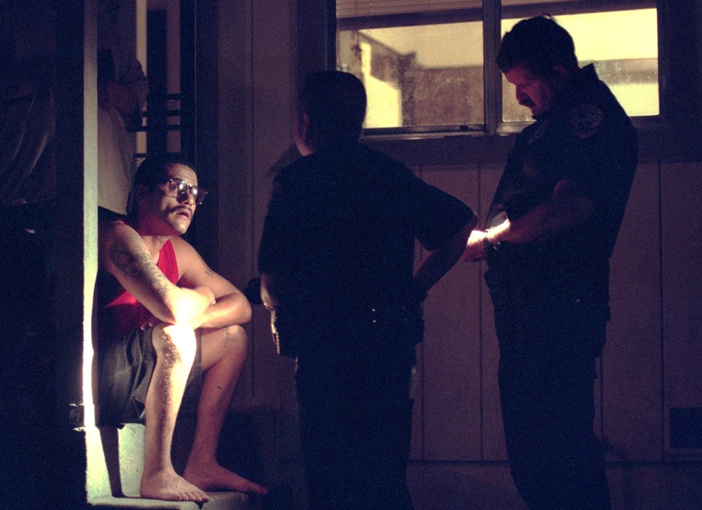 Officers Russ Skaden of the Visalia Police Department, right, and Robert Vasquez of the Farmersville Police Department interview Ray Salazar in June of 1999 about his activities that night. Salazar was later arrested for violating his parole terms. It was the second visit that night and they caught Salazar off guard smoking marijuana.