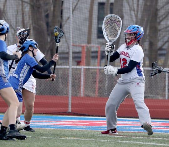 Carmel goalie Cat Babnik squares herself to face a shot from Hen Hud's Kira Varada March 18, 2019 at Carmel High School.