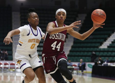Ossining's Aubrey Griffin (44) tries to get around South Shore's Rori Cox (0) during the girls Class AA semifinal in the Federation Tournament of Champions at the Cool Insuring Arena in Glens Falls March 22, 2019.