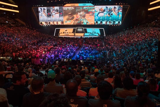 In this July 28, 2018, file photo, fans watch the competition between Philadelphia Fusion and London Spitfire during the Overwatch League Grand Finals competition at Barclays Center in the Brooklyn borough of New York. With eight new franchises and plans to take its regular season on the road for the first time, the Overwatch League is opening its second year a few steps closer to its goal of becoming a truly global, city-based esports league.