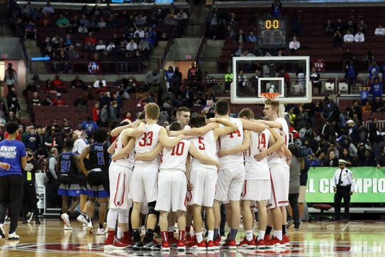 Sheridan gathers at center court after falling to Columbus South in the Division II state semifinals in Columbus.