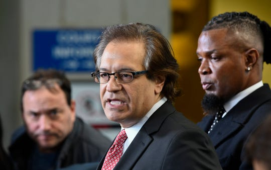 Lawyer Doug Anton,  left, and publicist Darrell Johnson, right, speaks to the media after R. Kelly's latest hearing in his criminal sex-abuse case.