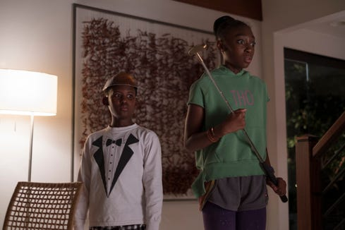 "Zora Wilson (Shahadi Wright Joseph, right, with Evan Alex) wields a putter to take out antagonists in the Jordan Peele horror film ""Us."""