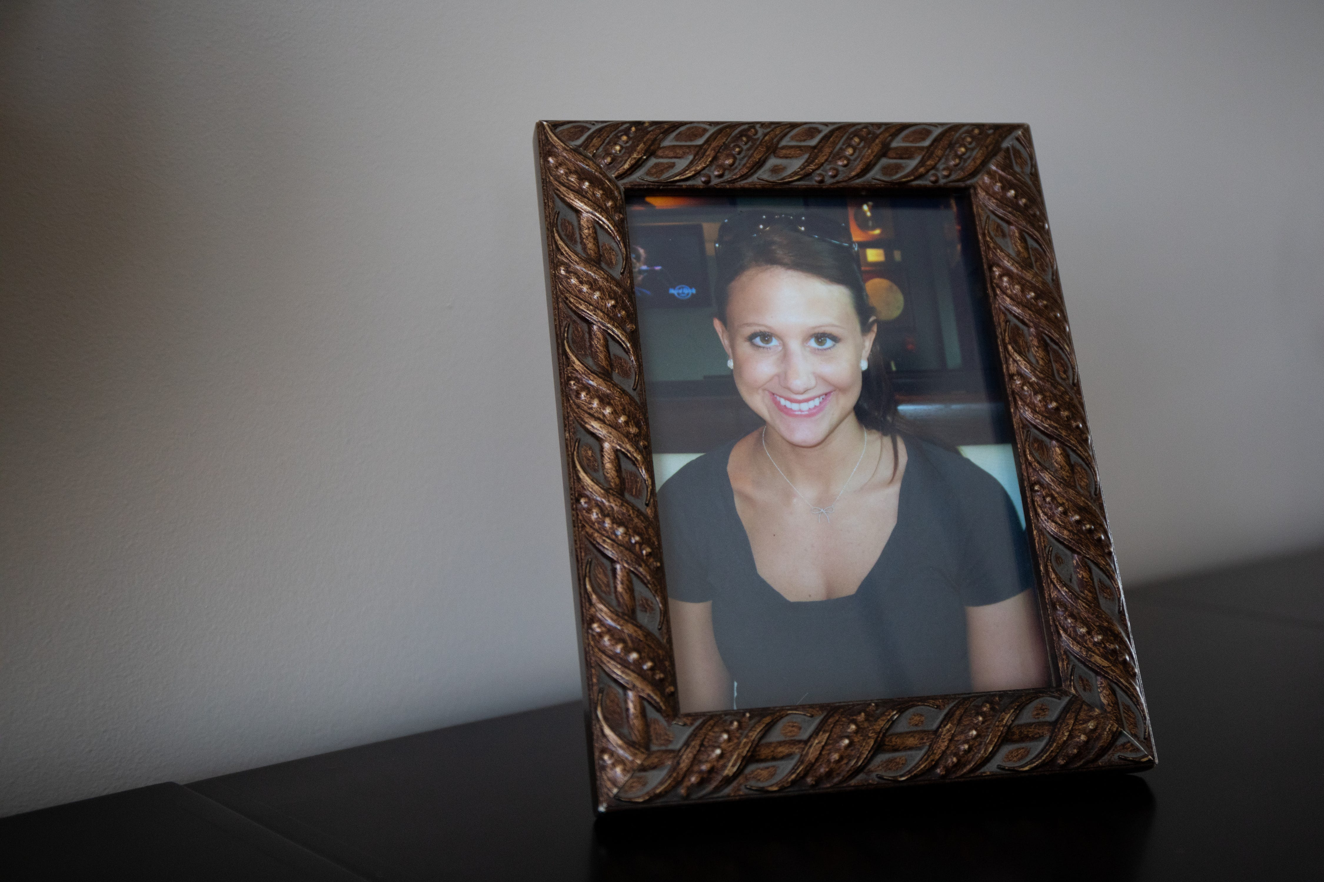 A framed picture of Lara Gass taken by her father, Jay Gass, in 2011 at a restaurant celebrating her brother's college graduation in Nashville, Tennessee, photographed in Ponte Vedra Beach, Fla. on March 18, 2019. Lara Gass died at age 27 on March 18, 2014 in a car crash caused by a faulty ignition switch.