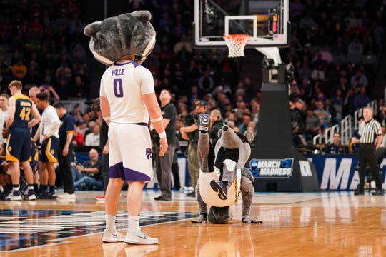 Peter the Anteater, right, performs on Friday while the Kansas State mascot watches.