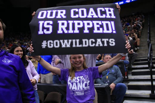 First round: A fan roots for the Abilene Christian Wildcats against the Kentucky Wildcats.