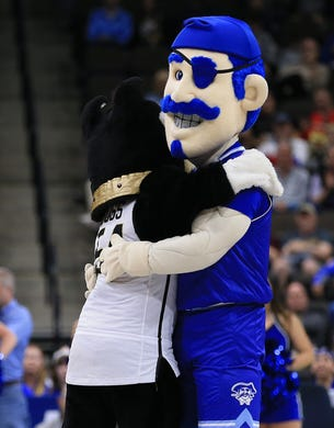 First round: The mascots for Wofford  and Seton Hall hug it out on the court.