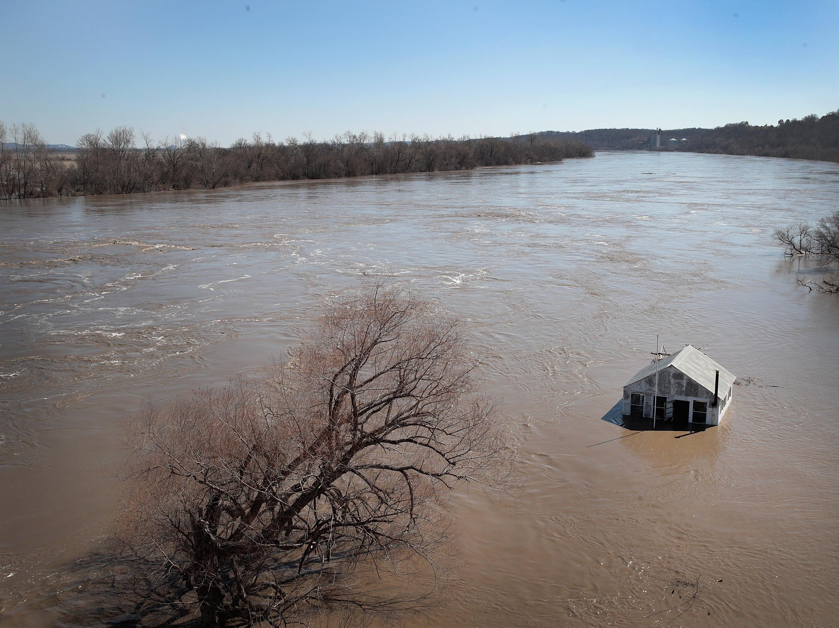 """A structure is surrounded by floodwater on March 21, 2019 in Atchison, Kansas. Several Midwest states are battling some of the worst flooding they have experienced in decades as rain and snow melt from the recent """"bomb cyclone"""" has inundated rivers and streams. At least three deaths have been linked to the flooding."""