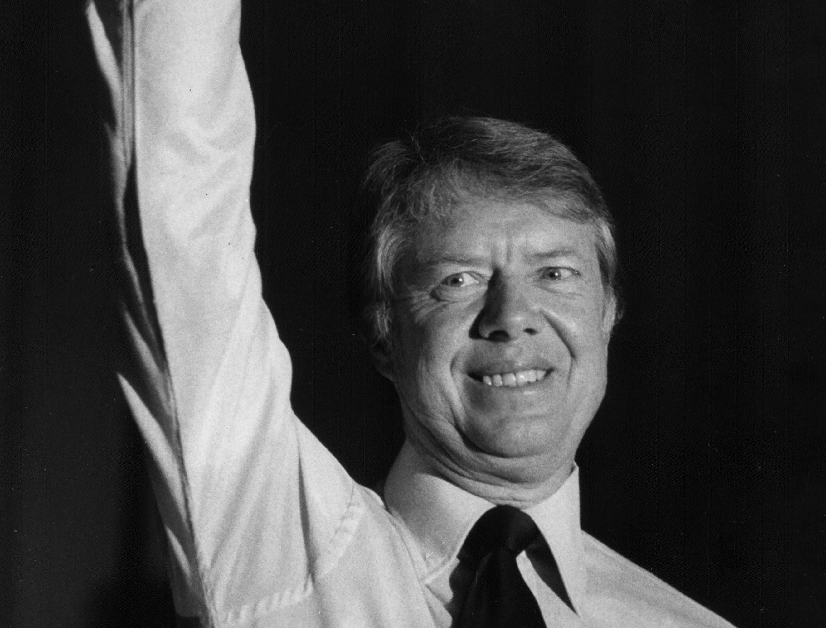 President Carter waves to the crowd at a rally in Paterson, N.J. on Oct. 23, 1976.