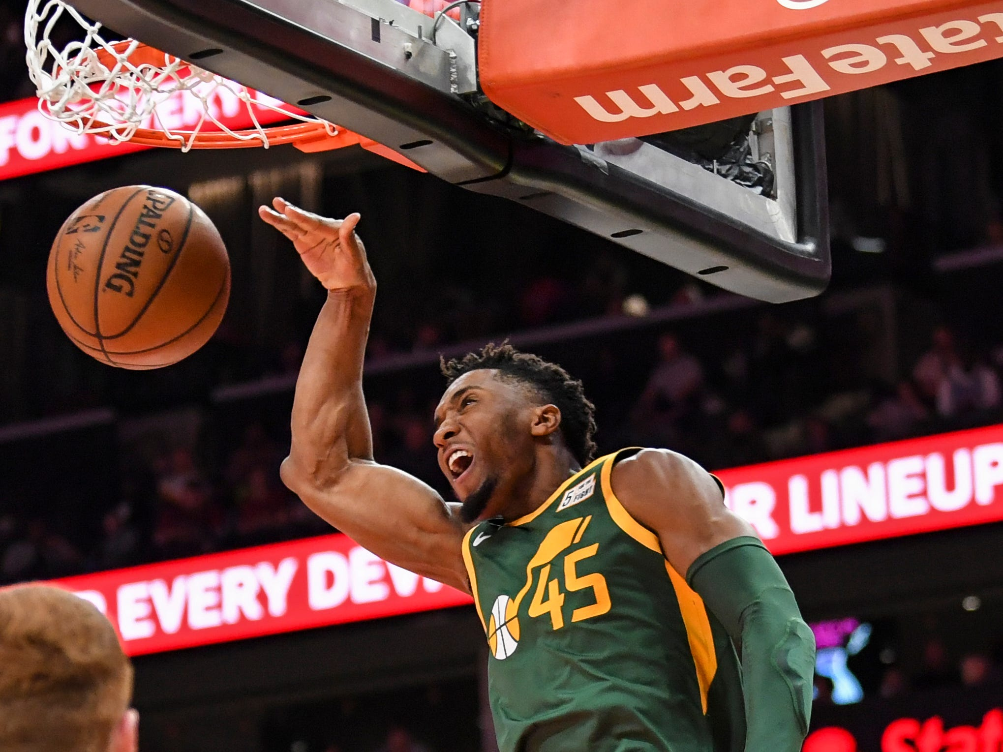 March 21: Utah Jazz guard Donovan Mitchell dunks against the Atlanta Hawks during the second half at State Farm Arena.