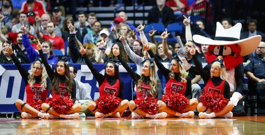 First round: The Texas Tech Red Raiders cheerleaders gesture during a free throw.