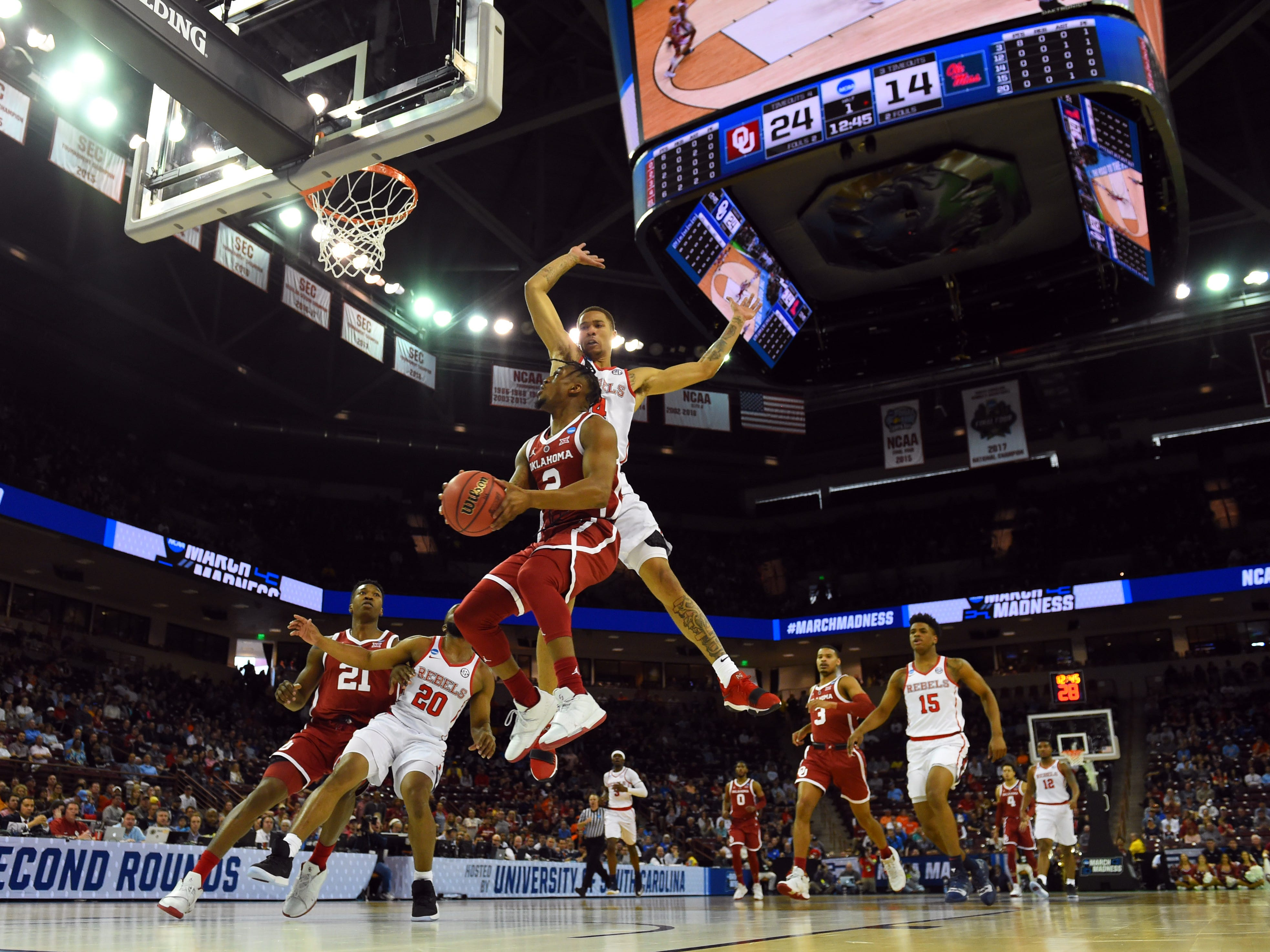 First round: Oklahoma guard Aaron Calixte goes up for a layup during the Sooners' rout of Ole Miss.