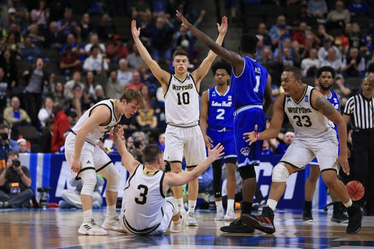 First round: Wofford guard Fletcher Magee celebrates with teammates after scoring against Seton Hall. Magee became the NCAA's Division I all-time leader in career 3-pointers during the win.