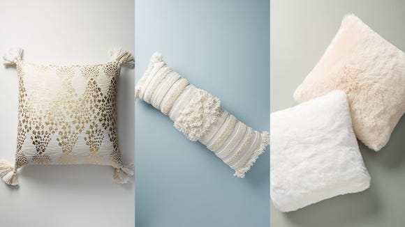 In order: Marcona, Textured Indira, and Fireside Faux Fur Throw Pillows