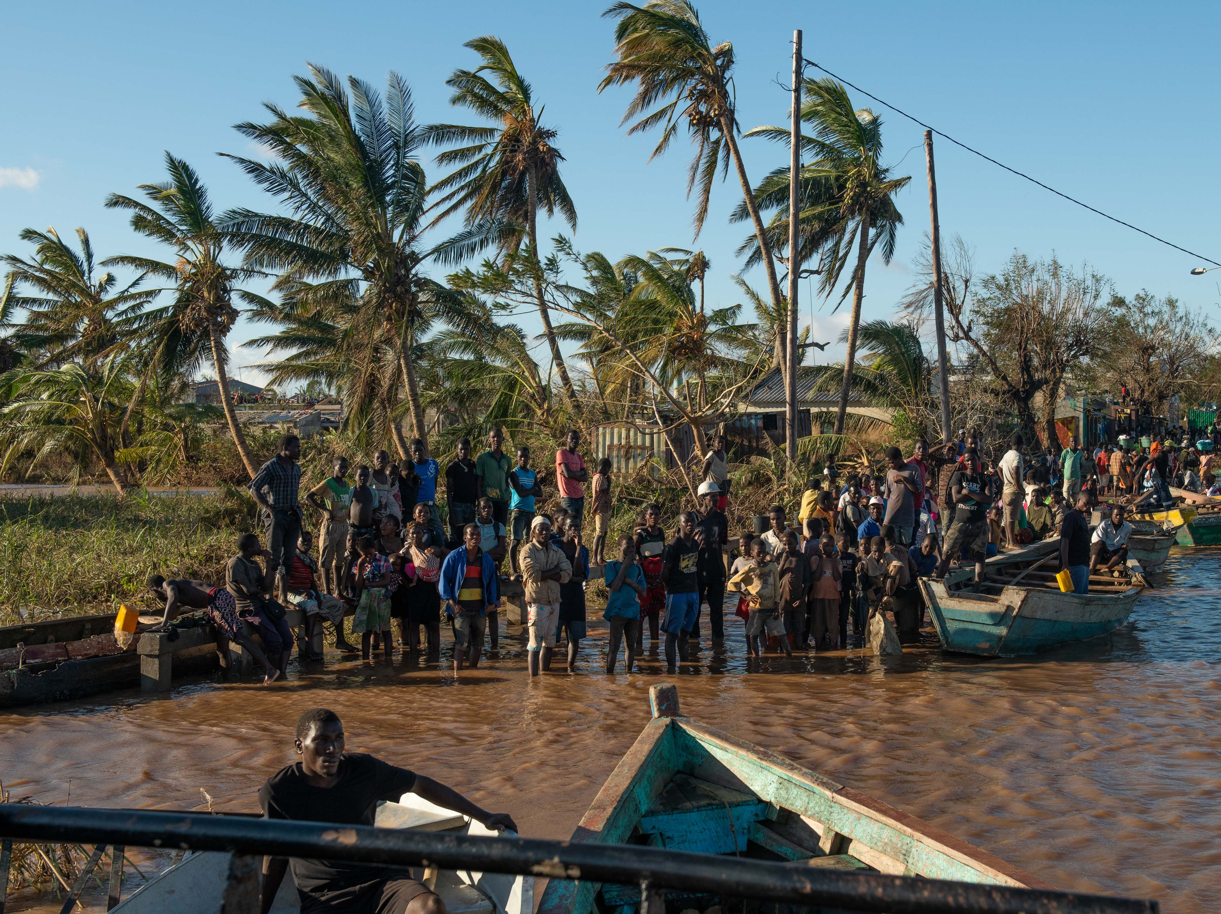 People stranded by Cyclone Idai wait for rescue by the Indian Navy on March 22, 2019 in Buzi, Mozambique. Thousands of people are still stranded after after the storm hit the country last week.