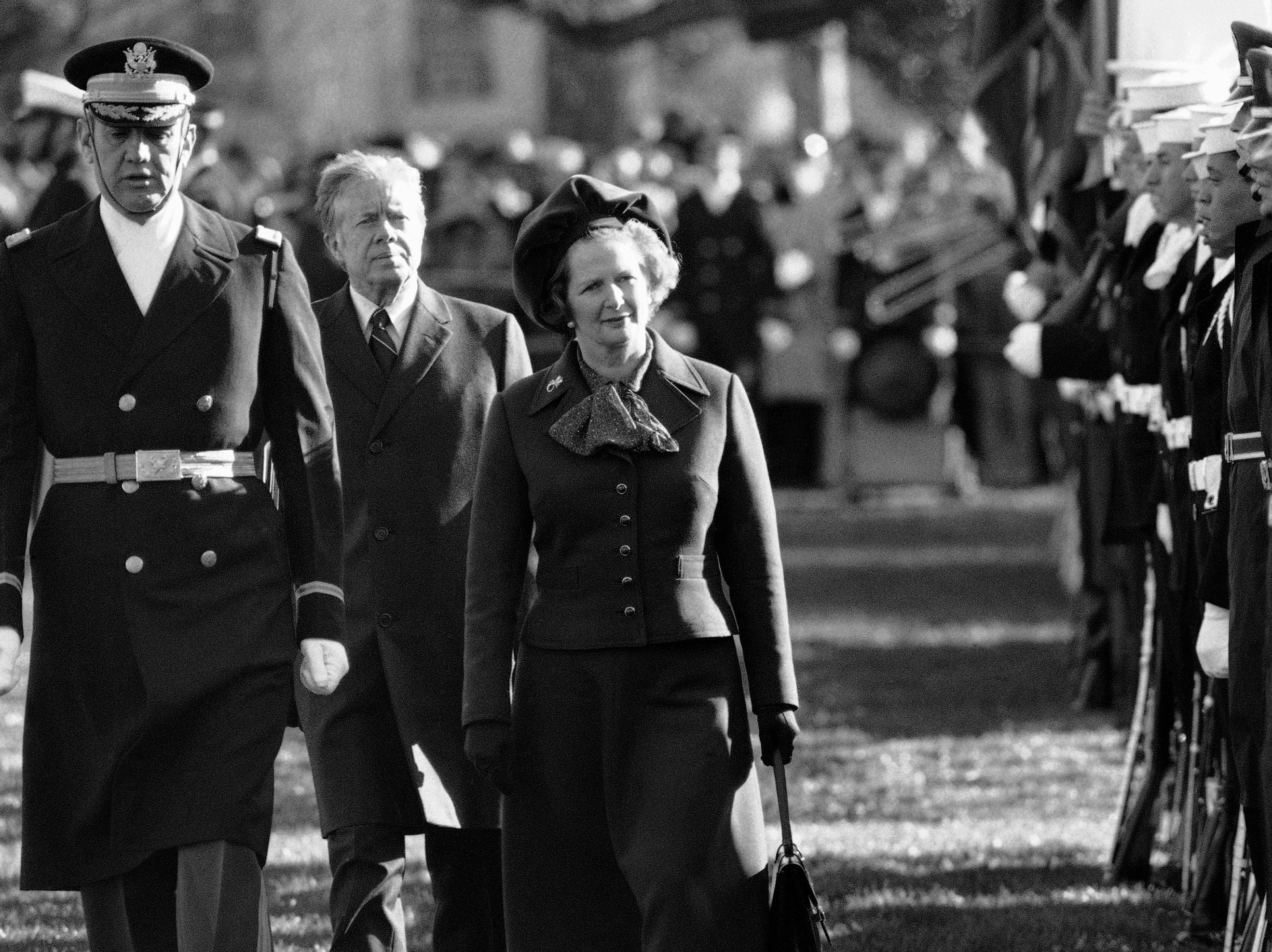 British Prime Minister Margaret Thatcher  reviews the honor guard at the White House in Washington, as President Carter follows on Dec. 17, 1979.