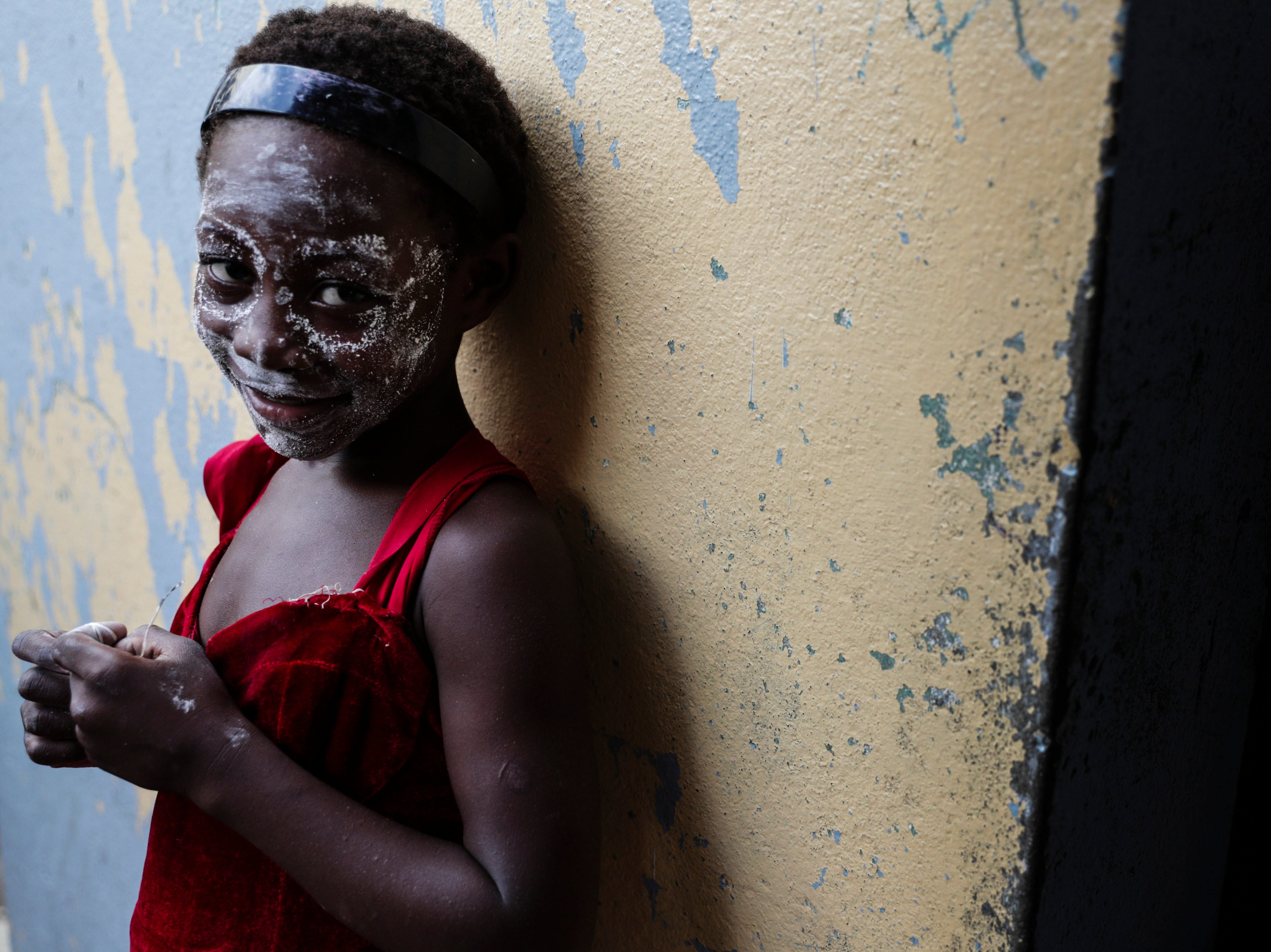 A girl takes shelter at Agostinho Neto School after the passage of Cyclone Idai, in Beira City, central Mozambique on March 22, 2019.