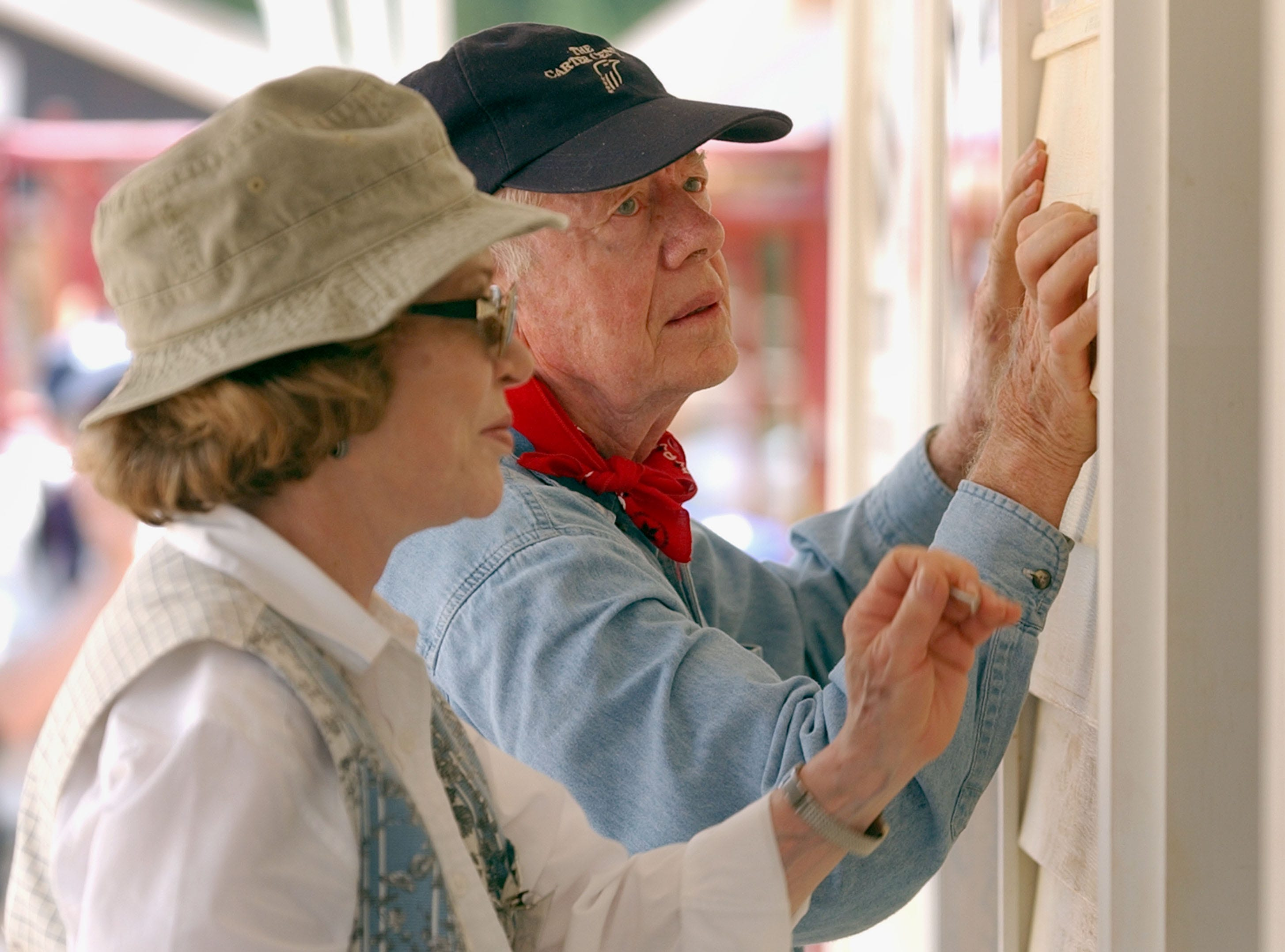 Jimmy Carter and his wife Rosalyn attach siding to the front of a Habitat for Humanity home being built on June 10, 2003, in LaGrange, Ga. More than 90 homes are being built in LaGrange; Valdosta, Georgia; and Anniston, Alabama by volunteers as part of Habitat for Humanity International's Jimmy Carter Work Project 2003.