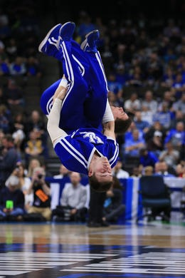 First round: A Kentucky Wildcats cheerleader performs during the game against the Abilene Christian Wildcats.