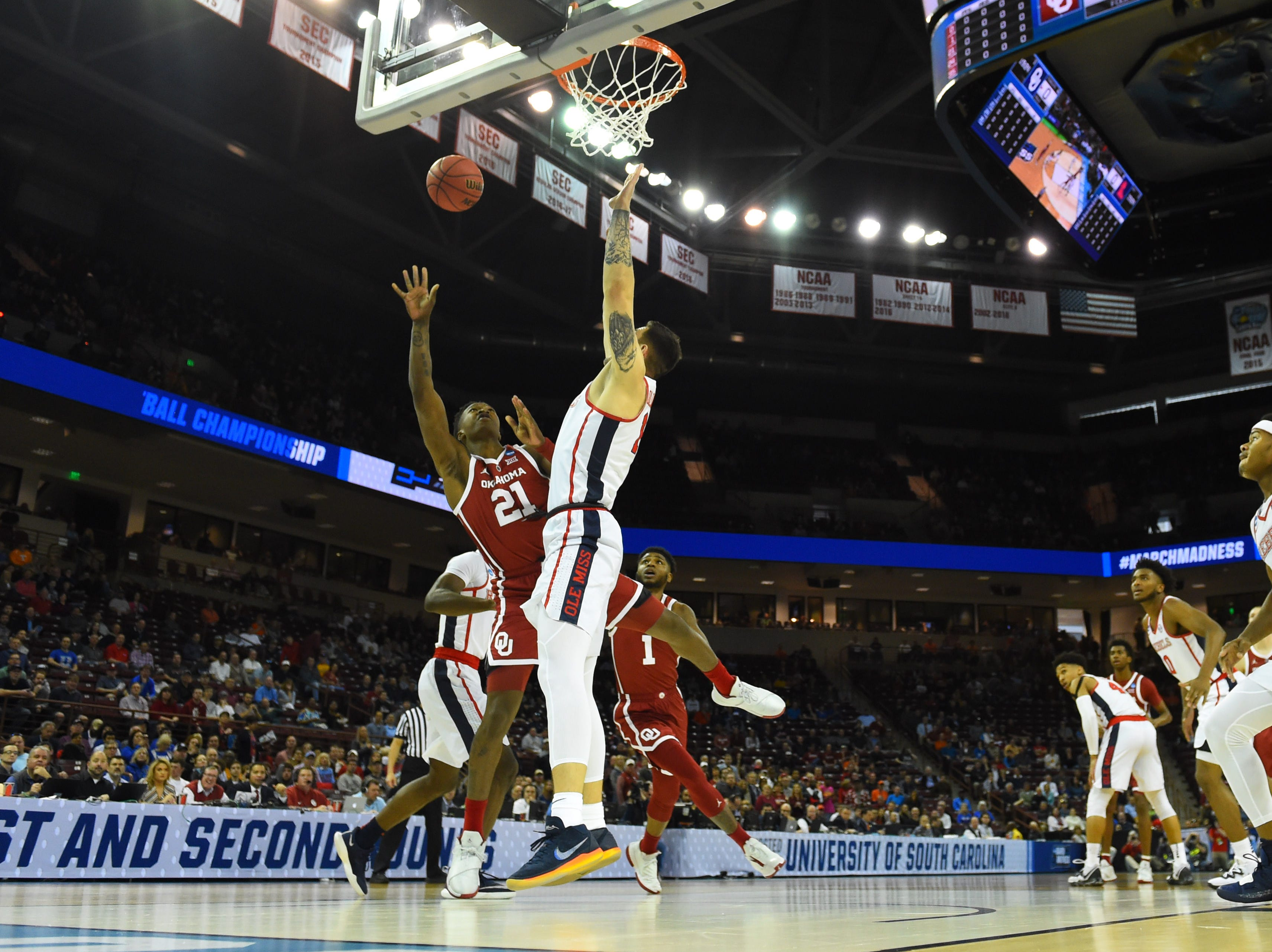 Oklahoma forward Kristian Doolittle (21) is defended by Mississippi center Dominik Olejniczak during the first round of the 2019 NCAA tournament
