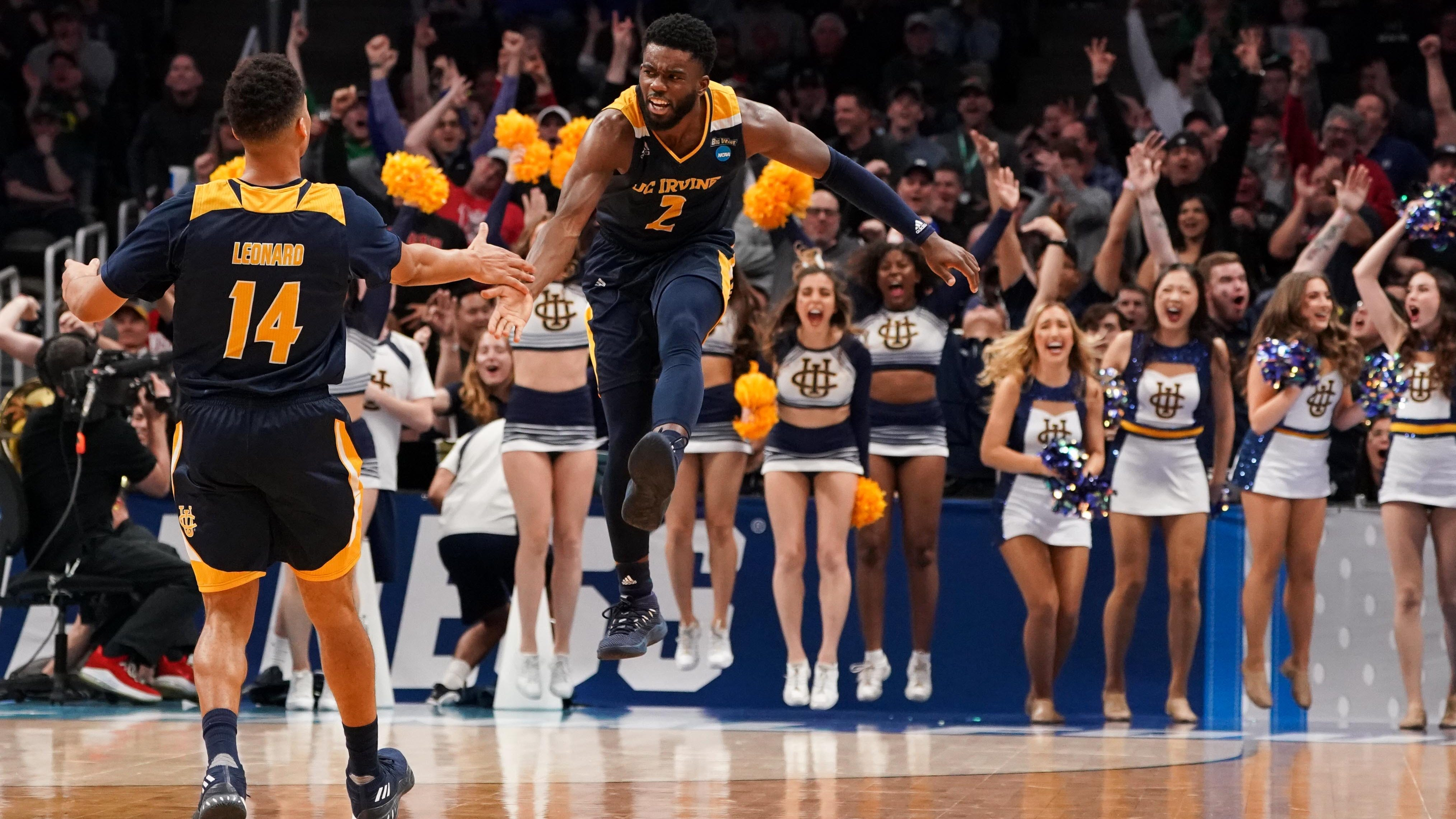 UC Irvine guard Max Hazzard (2) reacts with guard Evan Leonard during the first round of the 2019 NCAA tournament.