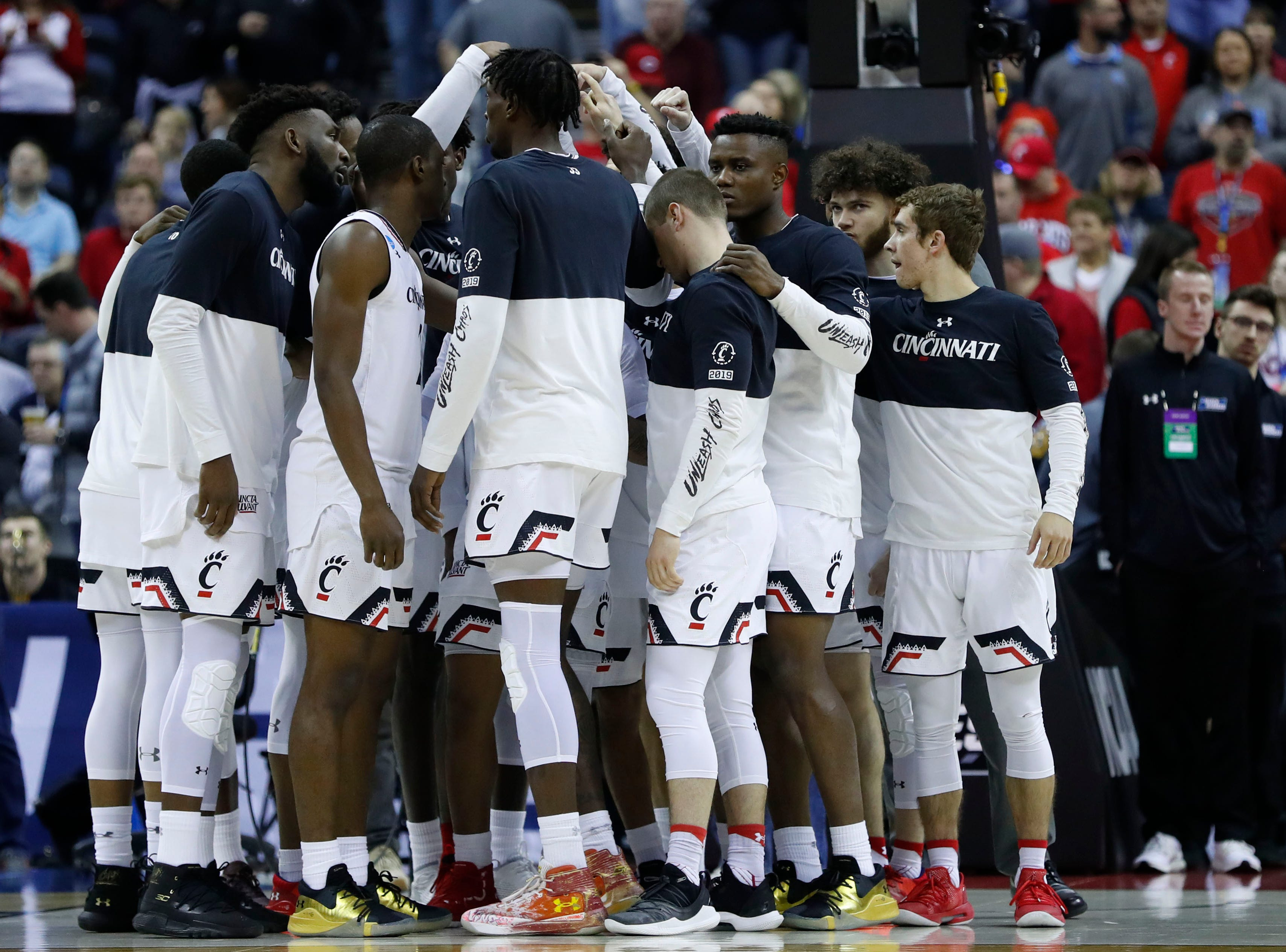 Cincinnati players huddle up before their game against Iowa in the first round of the 2019 NCAA tournament.