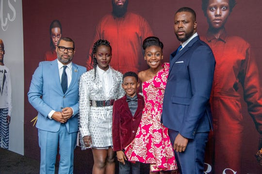 """Shahadi Wright Joseph (second from right) attends the """"Us"""" premiere with director Jordan Peele and co-stars Lupita Nyong'o, Evan Alex and Winston Duke."""