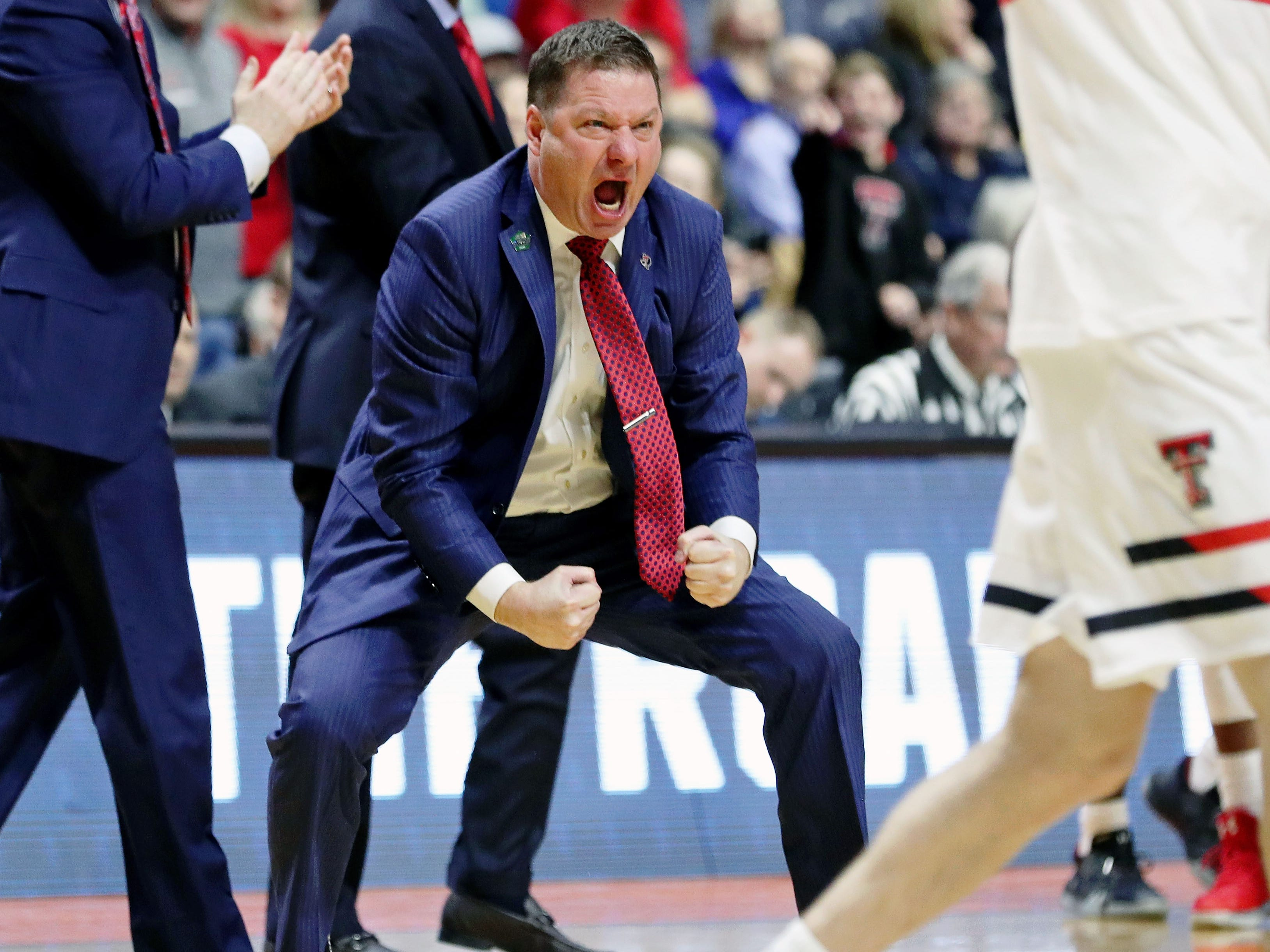 First round: Texas Tech Red Raiders head coach Chris Beard celebrates during his team's win over Northern Kentucky.