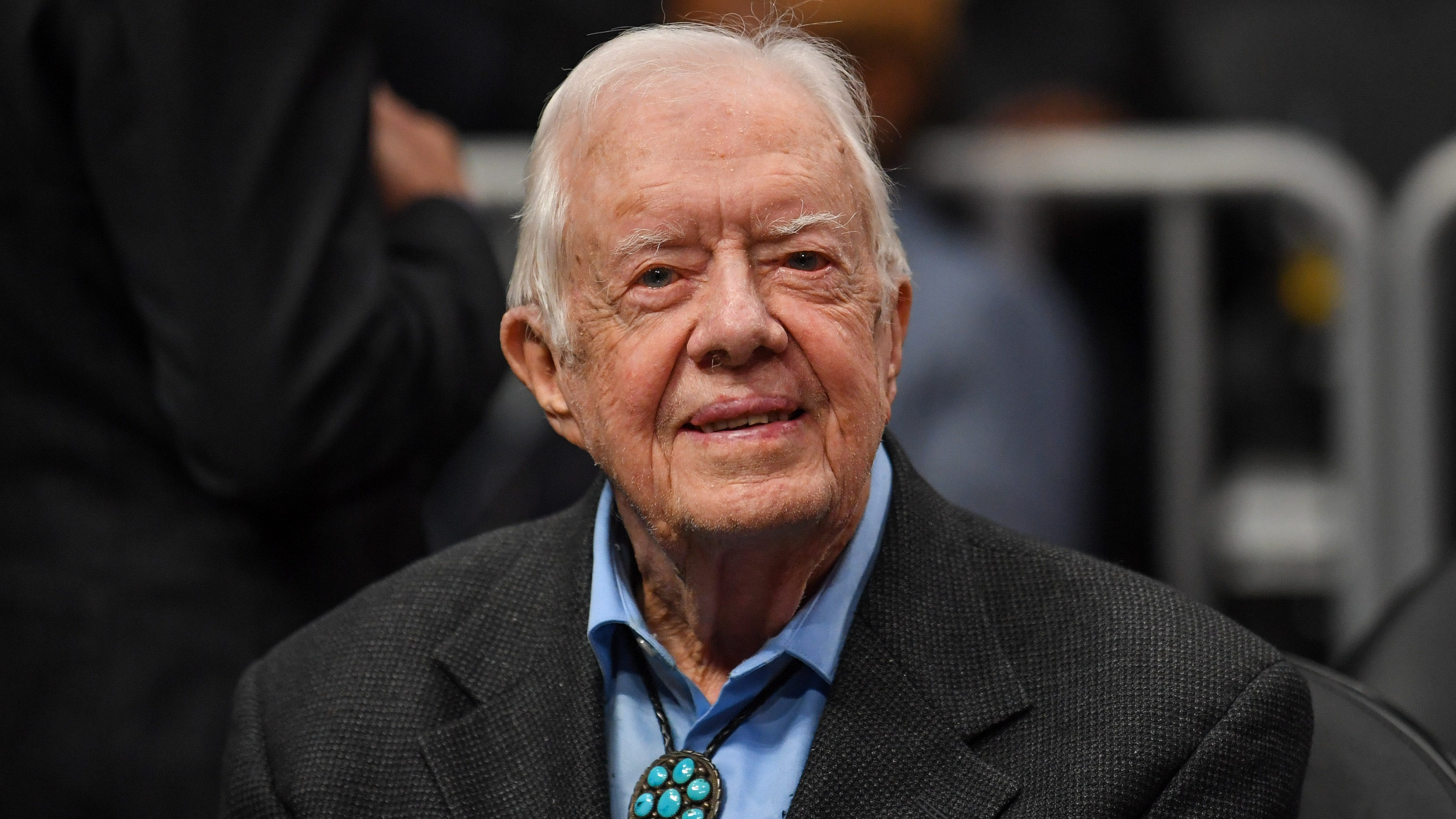 Jimmy Carter watches a basketball game between the Atlanta Hawks and the New York Knicks at State Farm Arena in Atlanta on Feb. 14, 2019.