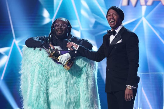 """Masked Singer"" winner T-Pain, dressed as Monster, with the show's host Nick Cannon."