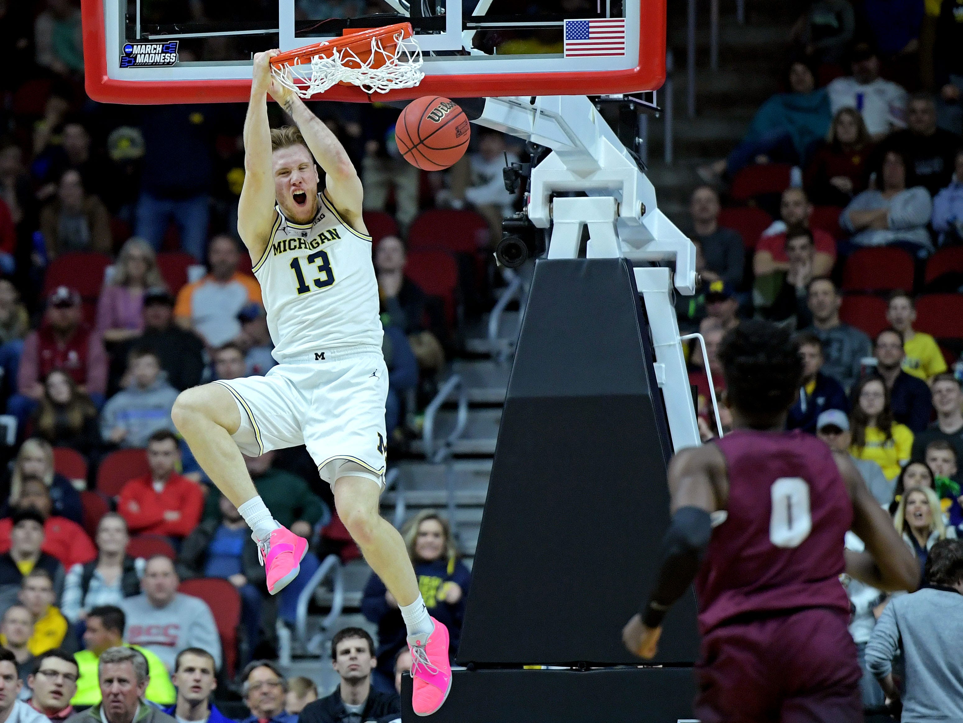 First round: Michigan forward Ignas Brazdeikis dunks the ball during the Wolverines' dominant win over Montana.